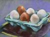 softpastel-eieren in een eierdoos van steen te koop